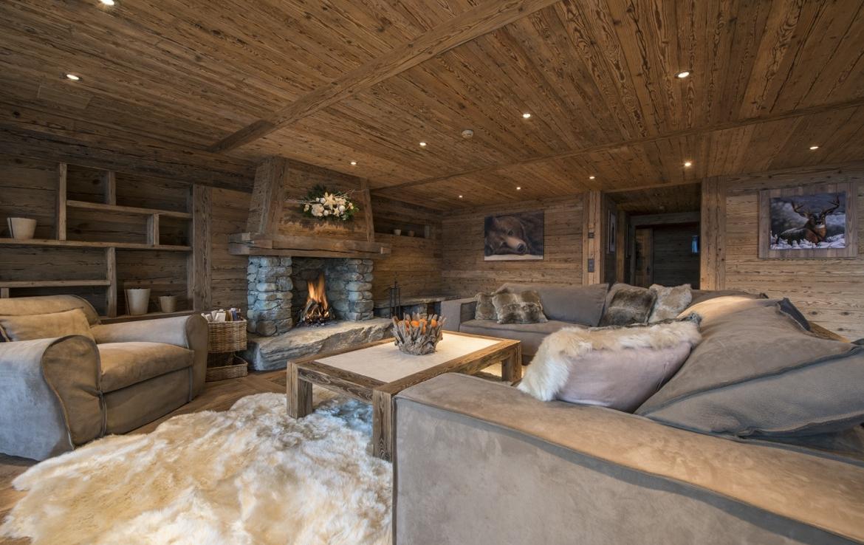 heinz-immobilier Luxueux appartement Verbier salon avec cheminée