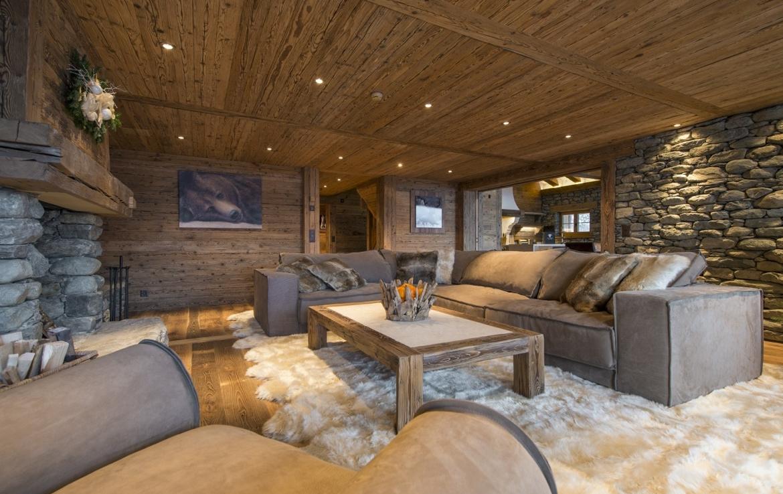 heinz-immobilier Luxueux appartement Verbier living parquet ancien avec cheminée